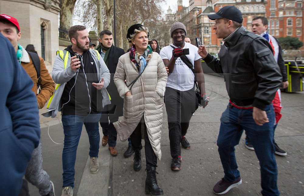 © Licensed to London News Pictures. 07/01/2019. London, UK. Conservative MP and Remain campaigner ANNA SOUBRY is heckled by a group of Brexit supporters, including JAMES GODDARD (second left) as she returns to the Houses of Parliament in London after appearing on broadcast television programs on College Green, Westminster. Photo credit:  George Cracknell/LNP