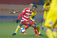 Doncaster midfielder Elliot Simões  shields the ball from Darnell Johnson of AFC Wimbledon  during the EFL Sky Bet League 1 match between Doncaster Rovers and AFC Wimbledon at the Keepmoat Stadium, Doncaster, England on 26 January 2021.
