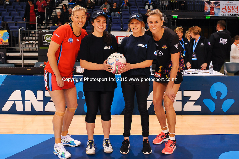 Future Captains Isabelle Chensem (L) and Natasha Waddell with Anna Thompson of the Tactix and Leana De Bruin of the Magic during the ANZ Championship match, Tactix v Magic, 31 May 2015. Copyright Photo: John Davidson / www.Photosport.co.nz