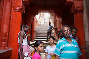 People on a backstreet near Dattatreya Ghat, by the Ganges river, in Varanasi, India.