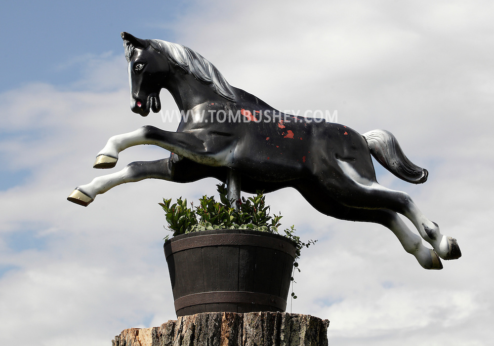 Bethel, New York - A carousel horse in a planter is on display at the entrance to the Rolling Stone Ranch on May 28, 2011.