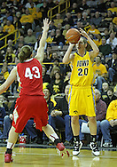 January 08 2010: Iowa forward Kelly Krei (20) puts up a shot over Ohio St. forward Sarah Schulze (43) during the first half of an NCAA womens college basketball game at Carver-Hawkeye Arena in Iowa City, Iowa on January 08, 2010. Iowa defeated Ohio State 89-76.