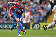 Connor Wickham of Crystal Palace taking a shot at goal. Barclays Premier League match, Crystal Palace v Stoke City at Selhurst Park in London on Saturday 7th May 2016. pic by John Patrick Fletcher, Andrew Orchard sports photography.