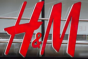 A H&M (Hennes & Mauritz AB) sign is pictured on 6 November 2020 in Windsor, United Kingdom. H&M is a Swedish multinational clothing-retail company which began as a Hennes ladieswear store in Sweden in 1947.