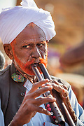 Traditional flute player at the Desert Festival on 29th January 2018  in Jaisalmer, Rajasthan, India. It is an annual event that take place in February month in the beautiful city Jaisalmer. It is held in the Hindu month of Magh February, three days prior to the full moon.