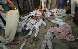 April 26, 2018 - Kushinager, Uttar Pradesh, India - (EDITORS NOTE: Image depicts death.)  People gather around dead bodies of children as a school van collided with a moving train in Kushinagar, Uttar Pradesh, on Thursday morning. (Credit Image: © Prabhat Kumar Verma/Pacific Press via ZUMA Wire)