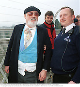 David Kirke's being arrested after his 21 St Anniversary  bungy jump off Clifton Suspension Bridge. 1 April 2000. <br /> <br />© Copyright Photograph by Dafydd Jones 66 Stockwell Park Rd. London SW9 0DA Tel 020 7733 0108 www.dafjones.com