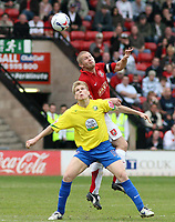 Photo: Mark Stephenson.<br />Walsall v Hereford United. Coca Cola League 2. 09/04/2007. Hereford's Alan Connell tries to win the ball from Walsall's Michael Dobson