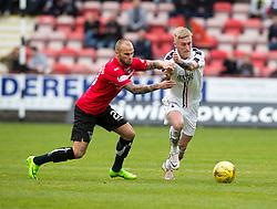 Dunfermline's Kallum Higginbotham and Falkirk's Craig Sibbald. Dunfermline 1 v 2 Falkirk, Scottish Championship game played 22/4/2017 at Dunfermline's home ground, East End Park.