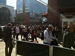 April 30, 2018 - San Francisco, CA, U.S. - SAN FRANCISCO, CA - APRIL 30: Fans and media wait outside the ball park after a fire alarm before the San Francisco Giants game versus the San Diego Padres on April 30, 2018, at AT&T Park in San Francisco, CA. The alarm was later determined to be a false alarm. (Photo by Stephen Hopson/Icon Sportswire) (Credit Image: © Stephen Hopson/Icon SMI via ZUMA Press)