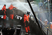 Animal Planet cameraman (center) films as Sea Shepherds onboard the M/Y Steve Irwin clash with Japanese whaling crew aboard harpoon ship, the Yushin Maru No. 3.  Sea Shepherds attacked the harpoon ship with bottles of butyric acid, while whalers retaliated with water cannons and projectiles of their own on during this confrontation in Antarctica's Southern Ocean on Thursday Feb. 5, 2009. (Photo by Adam Lau)