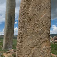 Mysterious 2700+ year-old, bronze age Deer Stones stand on a hillside called Ulaan Tolgoi, near Lake Erkhel & Muren, Mongolia.