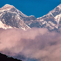 Mounts Everest and Lhotse tower over trekkers in the Khumbu region of Nepal.