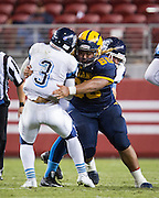 Milpitas offensive lineman Evander Ruiz, 60, lays a block on Valley Christian's Miles Kendrick, 3, during Friday Night Lights at Levi's Stadium in Santa Clara, California, on September 18, 2015.  Milpitas went on to lose 22-21 against Valley Christian.  (Stan Olszewski/SOSKIphoto)