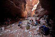 Tourists watching a girl playing the guitar,Grand Canyon River trip