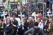 """Pro-choice protestors wave rainbow pride flags and chant slogans towards participants of """"The March For Life"""", seen in the foreground carrying crosses as they march through Berlin's Mitte district, on September 16, 2017. In the center of the pro-life march event was the call by the organizers for German politicians and society to take active action against a """"silent increase of acceptance"""" of the phenomenon. Abortion in Germany is permitted in the first trimester of the pregnancy, with the condition of mandatory counseling and in a later period of the pregnancy in cases of medical necessity.<br /> (Photo by Omer Messinger)"""