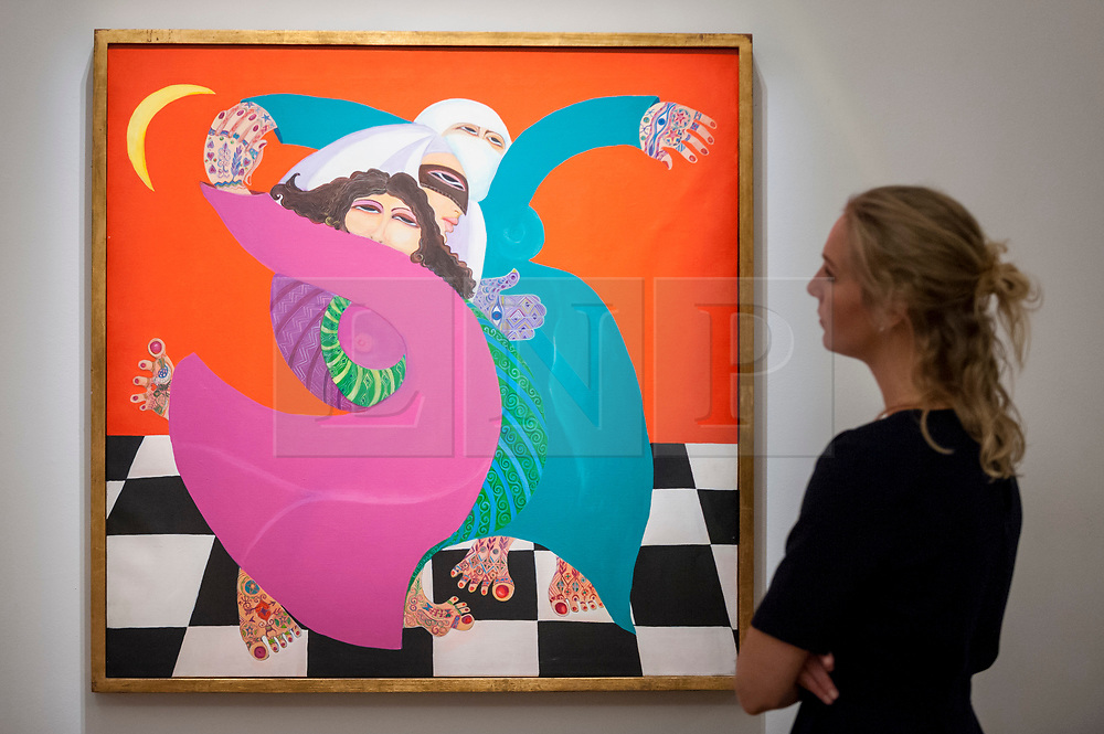 """© Licensed to London News Pictures. 20/10/2017. London, UK. A staff member views """"The Zar (from the Woman and Magic series)"""", 1992, by Laila Shawa, (GBP20-30k), at a preview of Islamic, Middle Eastern and other artworks which be auctioned at Sotheby's New Bond Street on 24 and 25 October. Photo credit : Stephen Chung/LNP"""