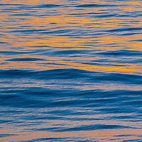 A sunset reflects in the Pacific Ocean near Santa Catalina Island, California.