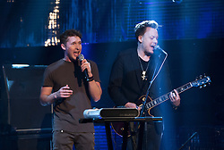 James Blunt (back) performing during filming of the Graham Norton Show at The London Studios.