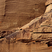 Ancient petroglyphs pecked into the sandstone by long vanished Ancestral Puebloans (Anasazi) in Canyon de Chelly NM, AZ.