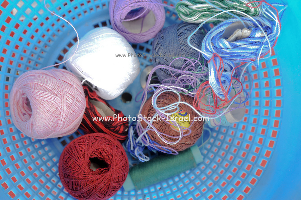 Sewing threads of different colours