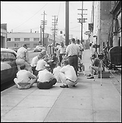 0001-600731. July 31 1960. Minor White teaching his Advanced workshop. Looking south on SW 2nd from about Madison. On the left is Boyd's coffee at the intersection of Jefferson, 1336 SW 2nd.  South Auditorium neighborhood.