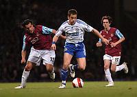 Photo: Tony Oudot.<br /> West Ham United v Chelsea. The Barclays Premiership. 18/04/2007.<br /> Joe Cole of Chelsea goes past Carlos Tevez of West Ham
