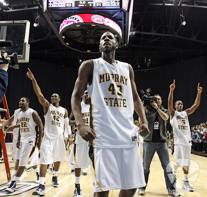 Murray State center Tony Easley (43) leads teammates forward Jeffery McClain (22), forward Ivan Aska (42), and guard Isaiah Canaan (3) as they celebrate their 62-51 victory over Morehead State in the Ohio Valley Conference Men's Basketball Championship game in Nashville, Tenn., Saturday, Mar. 6, 2010. (AP Photo/Frederick Breedon)