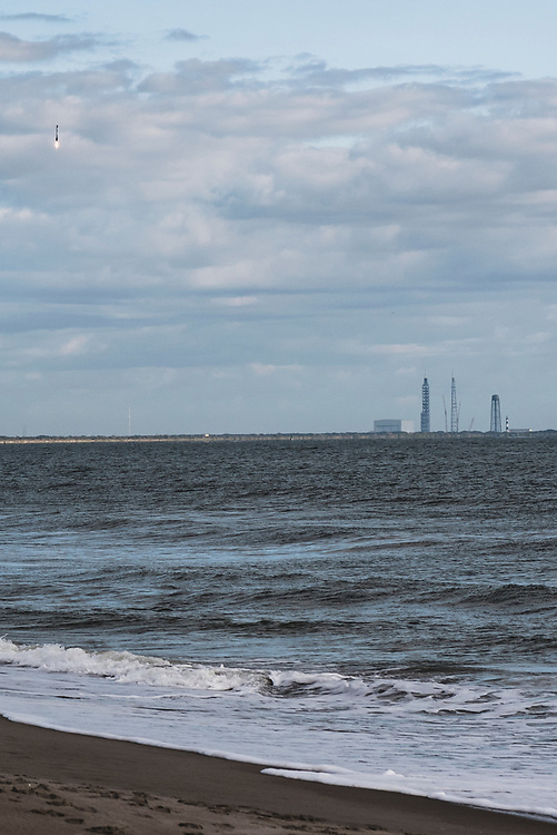 Cocoa Beach, Florida - December 19, 2020: About nine minutes after lift-off, a SpaceX Falcon 9 rocket booster returns for landing at Cape Canaveral Space Force Station after successfully launching a spy satellite into orbit. This was SpaceX's 26th and final launch in 2020.