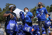 Los Angeles Dodgers Foundation chief executive officer Nichol Whiteman (left) poses with actress Annie Gonzalez (center) and actor Niko Guardado at the Dodger Day Drive-Thru at Belvedere Park, Tuesday, June 30, 2020, in Los Angeles. The event was hosted by The Los Angeles Dodgers Foundation, which distributed food boxes, books, sports equipment, clothing, toys and hygiene supplies to more than 1,000 registered youth from the Boyle Heights, East Los Angeles, La Puente and Monterey Park communities.