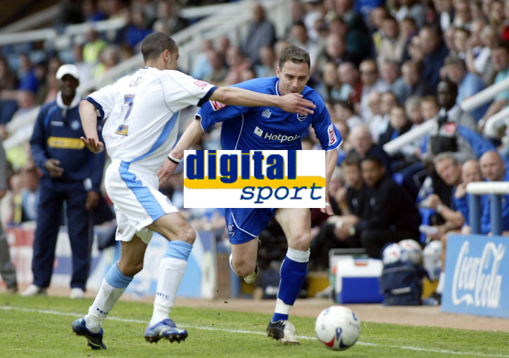 Photo: Marc Atkins.<br /> <br /> Peterborough United v Wycombe Wanderers. Coca Cola League 2. 06/05/2006. David Farrell of Peterborough (R) tries to shake of the advance of Wycombe's Danny Senda.(L)