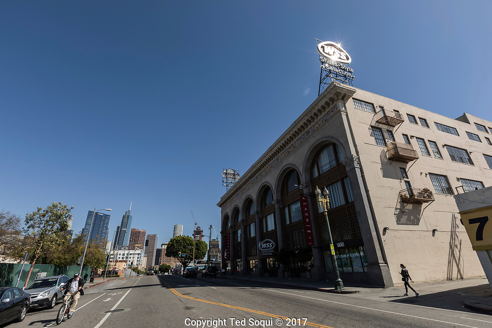 25 years later, the building was restored and a WSS shoe store where a former swap meet mall was was. The upper floors are now fancy lofts. The Pico/Union area has seen spotty redevelopment since the LA92 riots.<br /> 7th street at S.Union Ave<br /> <br /> 25 before and after LA92 photo project.