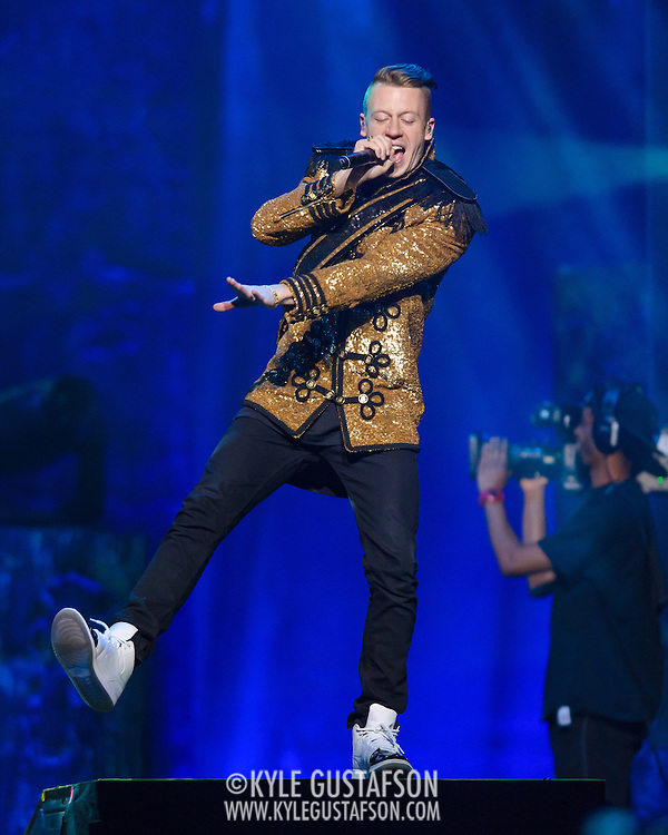 """WASHINGTON, DC - November 18, 2013 - Macklemore performs at the Verizon Center in Washington, D.C. The Heist, his 2012 album with producer Ryan Lewis, contained the #1 singles """"Thrift Shop"""" and """"Can't Hold Us."""" (Photo by Kyle Gustafson / For The Washington Post)"""