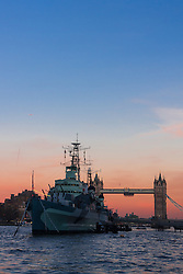 London, November 24th 2014. With London having enjoyed a clear if cold day, weather forecasters are predicying a cold night with temperatures expected to dip as low as 3 degrees in the early hours of Tuesday. PICTURED: HMS Belfast breaks the chilly post-sunset skyline.