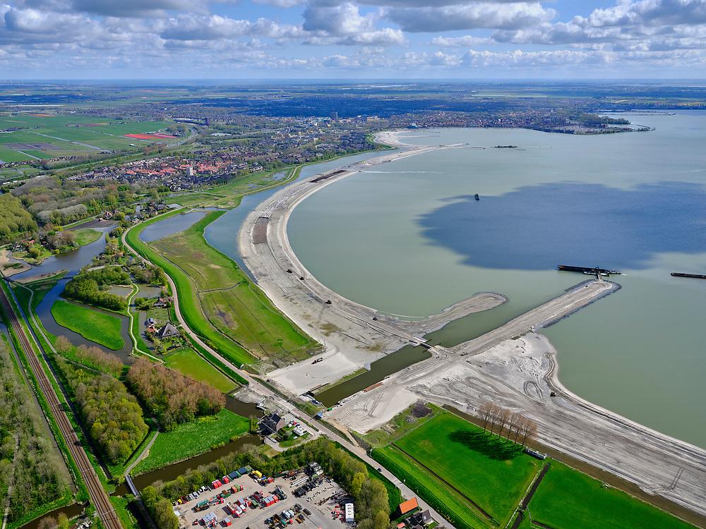 Nederland, Noord-Holland, gemeente Koggenland; 07-05-2021; Hoogheemraadschap Hollands Noorderkwartier, omgeving De Hulk met onder Scharwoude met dijkmagazijn aan de IJsselmeerdijk. In het kader van de dijkverbetering wordt er een oeverdijk aangelegd, de nieuwe halfhoge dijk heeft een buitentalud wat voor de bestaande dijk aangebracht wordt. Ter hoogte van gemaal Westerkogge is reeds een uitwateringskanaal zichtbaar. Zicht op Hoornse Hop.<br /> Hollands Noorderkwartier water board, area De Hulk, Scharwoude at the bottom with a dike warehouse on the IJsselmeerdijk. As part of the dyke improvement, an embankment dyke is being constructed, the new half-height dyke has an outer slope which will be installed in front of the existing dyke. A discharge channel is already visible near the Westerkogge pumping station.<br /> <br /> luchtfoto (toeslag op standard tarieven);<br /> aerial photo (additional fee required)<br /> copyright © 2021 foto/photo Siebe Swart