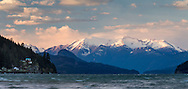 Mount Breakenridge towers above the waves on Harrison Lake.  Photographed from Harrison Hot Springs, British Columbia, Canada