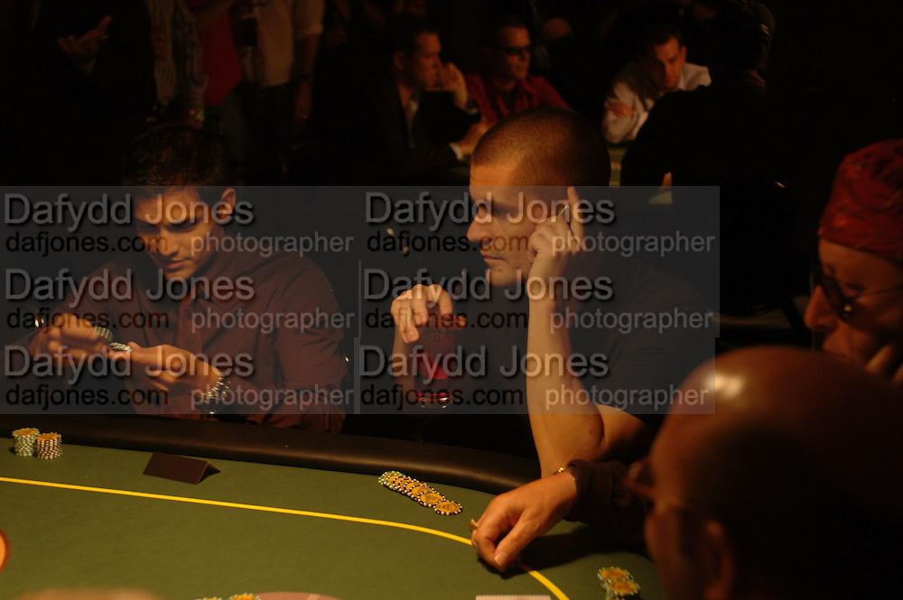 Nicholas Gonzales and Gus Hanson. Opening Night Party of the first  cards tournament hosted by online poker website World Poker Exchang. Old Billingsgate Market, London. 3 August 2005. ONE TIME USE ONLY - DO NOT ARCHIVE  © Copyright Photograph by Dafydd Jones 66 Stockwell Park Rd. London SW9 0DA Tel 020 7733 0108 www.dafjones.com