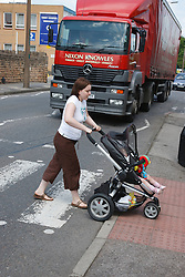 Mother crossing road with baby
