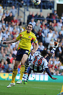 Sunderland's John O'Shea (l) blocks an overhead shot from West Brom's Stephane Sessegnon. Barclays Premier league match, West Bromwich Albion v Sunderland at the Hawthorns in West Bromwich, England on Sat 21st Sept 2013. pic by Andrew Orchard, Andrew Orchard sports photography,
