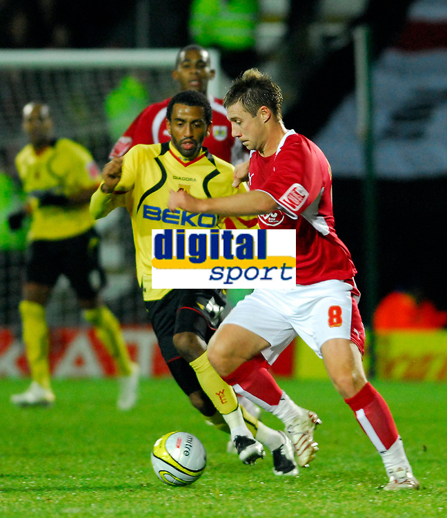 Photo: Leigh Quinnell/Sportsbeat Images.<br /> Watford v Bristol City. Coca Cola Championship. 01/12/2007. Bristol Citys David Noble keeps the ball from Watfords Lee Williamson.