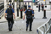 Police walking through Downing Street are seen carrying their bottle of water as temperatures rise in London on Wednesday, May 27, 2020. The prime minister's populist appeal has been hammered by the news that, as the coronavirus outbreak raged, chief adviser Cummings drove 250 miles (400 kilometres) to his parents' house while he was falling ill with suspected COVID-19 allegedly flouting lockdown rules that the government had imposed on the rest of the country. (Photo/ Vudi Xhymshiti)