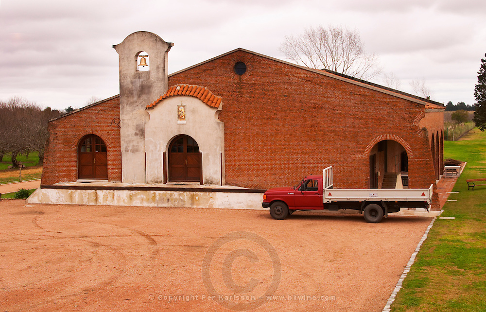 The winery building with it's distinctive bell tower, and a truck. Bodega Bouza Winery, Canelones, Montevideo, Uruguay, South America