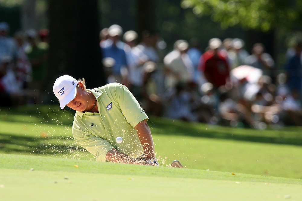 09 August 2007: Ernie Els chips out of the green-side bunker on the 1st hole during the first round of the 89th PGA Championship at Southern Hills Country Club in Tulsa, OK.