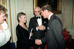 PA NEWS PHOTO 28/10/93  THE PRINCE OF WALES GREETS ACTRESS DAME JUDI DENCH, WHILE ACTOR SIR JOHN GIELGUD LOOKS ON. THE PRINCE OF WALES AS PRESIDENT OF THE ROYAL SHAKESPEARE COMPANY TONIGHT HOSTED AN EVENENING OF SHAKESPEARE'S WORK IN LONDON