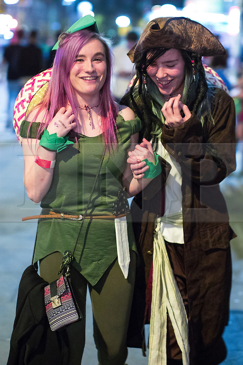 © Licensed to London News Pictures . 07/04/2017 . Manchester , UK . A Disney themed pub crawl passes through The Printworks in Manchester City Centre . Greater Manchester Police have authorised dispersal powers and say they will ban people from the city centre for 48 hours , this evening (7th April 2017) , in order to tackle alcohol and spice abuse . Photo credit : Joel Goodman/LNP