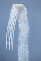 United States, Washington, Seattle, five jets diving in unison during Blue Angels air show at annual Seafair Festival
