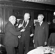 27/01/1962<br /> 01/27/1962<br /> 27 January 1962<br /> Presentation College, Cork P.P.U. (Dublin Branch) Dinner at Jammets restaurant, Dublin. Picture shows outgoing President Mr. Frank Gallagher (left) placing the chain of office on the new President, Padraig O'Caoimh (centre) before the dinner. Included is Dr. N.G. Nolan, Vice-President of the Union.