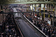 Seen from an aerial perspective during a rail strike in the 90s, on both sides of the railway track, thousands of commuters desperate to get home after a long day at work in central London, on 22nd June 1993, in London, England.