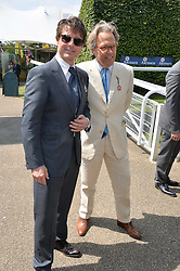 Left to right, TOM CRUISE and the EARL OF MARCH at the 2014 Glorious Goodwood Racing Festival at Goodwood racecourse, West Sussex on 31st July 2014.