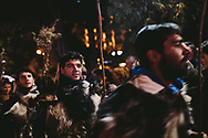 Men and women danced through Syntagma square, wearing traditional clothes and waving olive branches, during a pro government rally in Athens on Sunday.